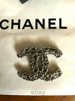 Chanel Brooch with box and bag authentic never worn